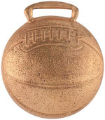 BASKETBALL SHAPED DOMED BRASS SHELL TO ACCENT A BUTTON.
