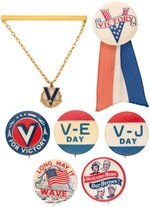 WORLD WAR II SIX VICTORY BUTTONS PLUS VICTORY BRASS/ENAMEL TIE BAR.