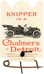 CHALMERS-DETROIT CELLO FLIP BADGE NAMING 1909 AAA RACE AND WINNER.
