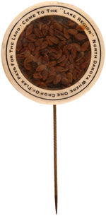CPB PRODUCTS #319 SCARCE NORTH DAKOTA BUTTON FEATURING REAL FLAX SEEDS.